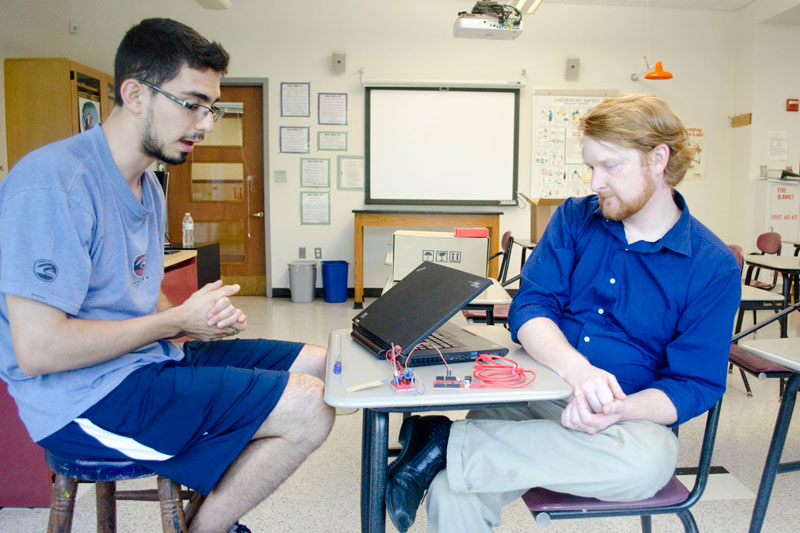 Graduate student working with high school teacher.