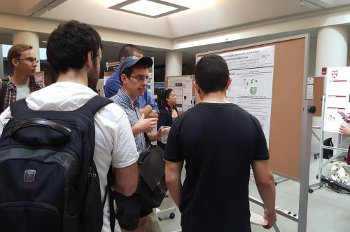 Physics/PEB student presenting his Integrated Workshop project on the optimization of a microfluidic device used to single-cell trapping at the 2016 iPoLS meeting..