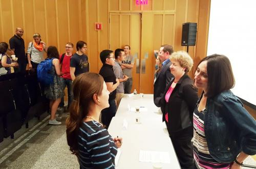 Panelists after the 'Careers in Industry' event talking with audience members