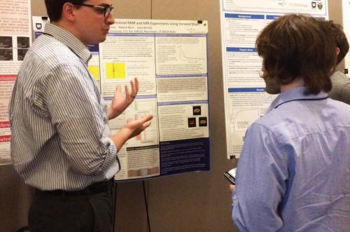 2015 meeting: Physics graduate student presenting his research.